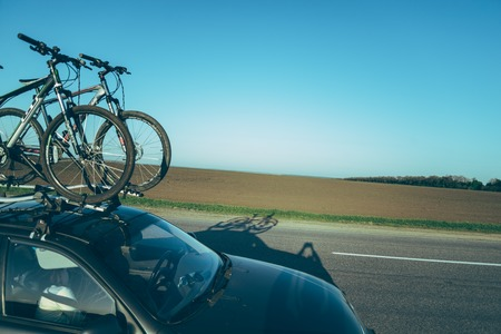 displacement: road with shadow of the car with bicycle on the roof Stock Photo