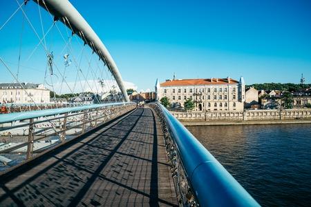 the furlough: empty bridge in sunny sumer evening