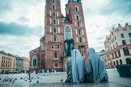 tabernacle: nun looking on old church Stock Photo