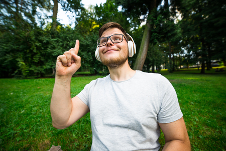 man get an idia while sitting in the park Stock Photo