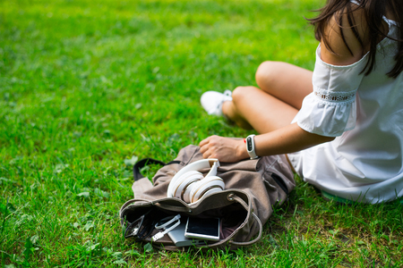 backpack with water, mobile phone and powerbank inside Stock Photo