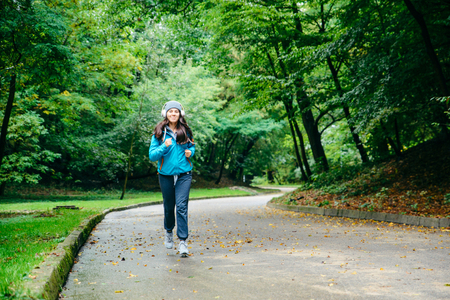 young pretty woman run utside in the park Stock Photo