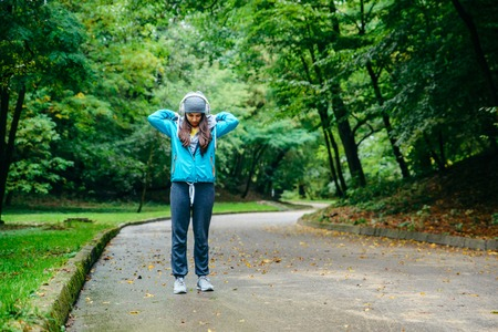 young pretty woman was interrupted video call while run in the park Stock Photo