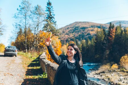 woman taking picture of carpathian mointains Stock Photo