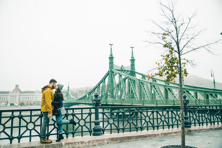 the furlough: couple kissing near old bridge in the morning