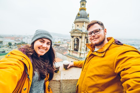 the furlough: couple take a selfie with beautiful cityscape on background