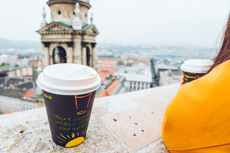 two cups of coffe panormaic view to old european city