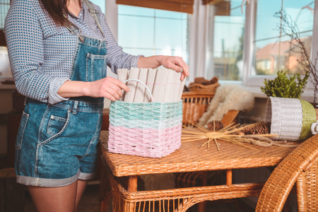 young pretty woman making baskets, home business Banque d'images