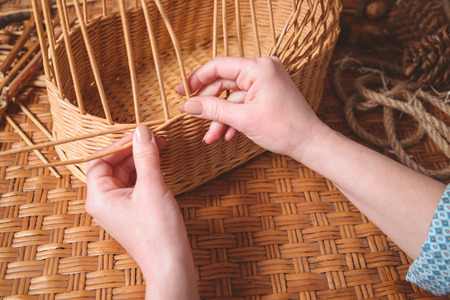 Young pretty woman making baskets, home business