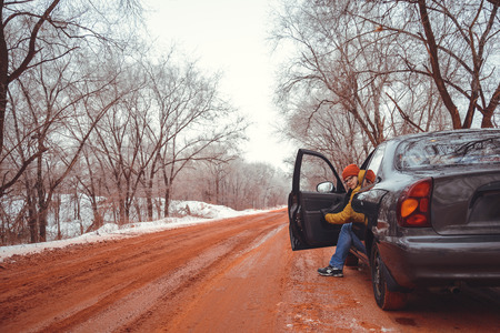 man goes out the car in winter day road red of ore Stock Photo