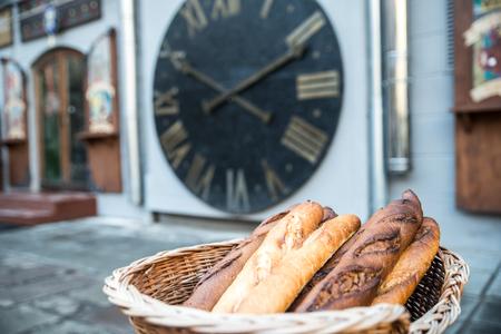 long loaf bread in wicker basket outside Stock Photo