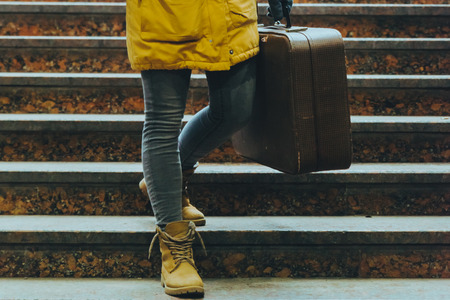 woman lages close up on stairs with bags