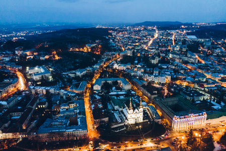 Panoramic view of old european city on twilight with red sky. birds eye view.