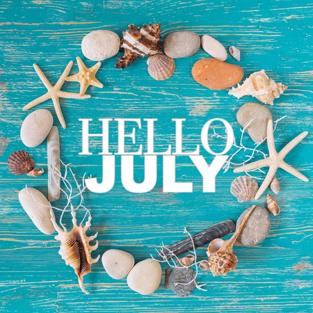 hello july text in circle of sea shells. title concept