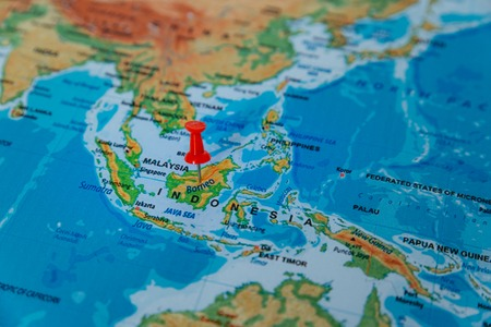 pins on the map close up to borneo. soft focus 版權商用圖片
