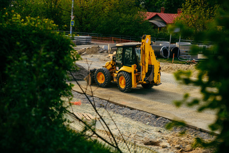 construction site. heavy machines making street road on sunset Stock Photo