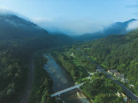 aerial view for mountains with forest. mist comes up from woods. nature landscape