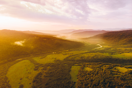 aerial view of carpathian mountains on sunset. magic mist