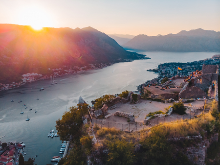 aerial view of kotor bay with kotor city on sunset. red sunshine over city