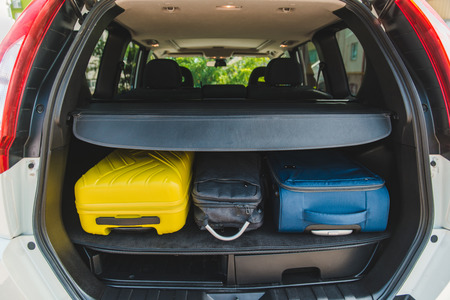 car trunk with loaded bags. car travel concept. road trip