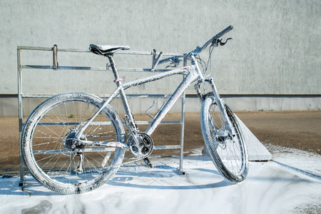 mtb bicycle in soap. self-service. bicycle washing