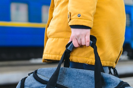 woman take bag at railway station. travel concept
