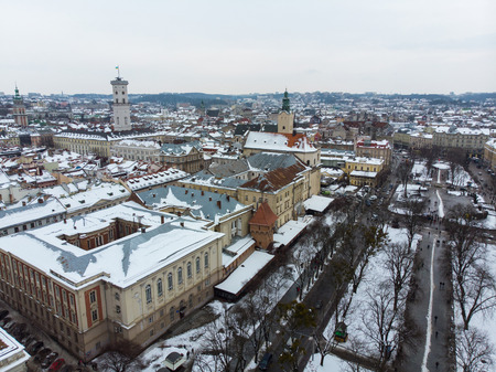 old european city aerial view in winter time. snowed roofs Stock Photo