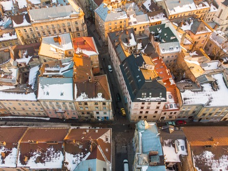 aerial view on narrowly streets of european city. evening time Stock Photo