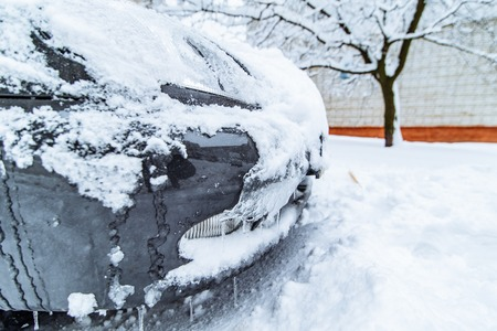 car in ice and snow parked in yard. winter time Stock Photo