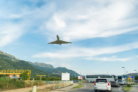 cars on road and plane in sky. travel concept. copy space Stock Photo