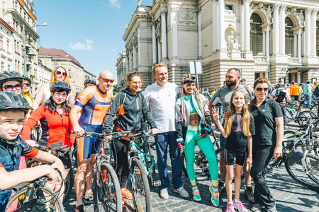 LVIV, UKRAINE MAY 20, 2018: lviv bicycle day in center of the city. Sportsmen taking photo with mayor of the city Editorial