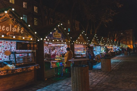 LVIV, UKRAINE - December 12, 2017: christmas festival at lviv square. market with street food concept Editorial