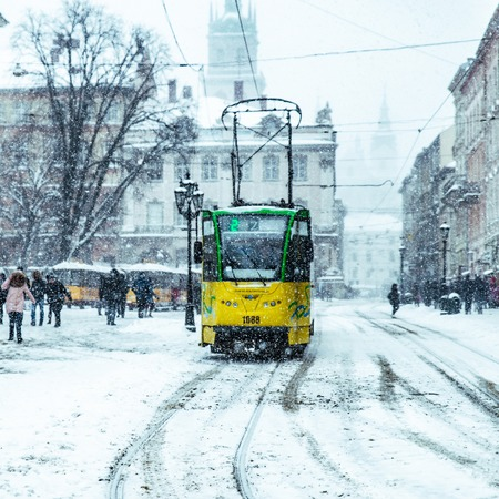 LVIV, UKRAINE - March 18, 2018: center of european town covered by snow. snowstorm collapse Editorial