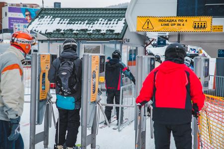 BUKOVEL, UKRAINE - December 9, 2018: people in line to lift skiing and snowboarding winter activity