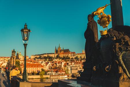 PRAGUE, CZECH REPUBLIC, September 22, 2018: tourists walking by charles bridge in the morning