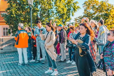 PRAGUE, CZECH REPUBLIC - September 22, 2018: group of asian tourists at european town Editorial