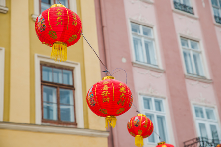 chinese new year decoration lights at european city streets. holidays concept