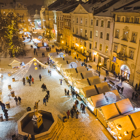 LVIV, UKRAINE - December 15, 2018: aerial view on christmas fest at square of old european city. winter vacation