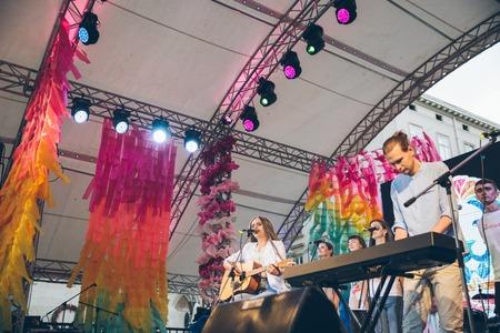 LVIV, UKRAINE - June 23, 2018: people listening music from the scene. music fest