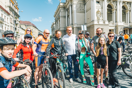 LVIV, UKRAINE – MAY 20, 2018: lviv bicycle day in center of the city. Sportsmen taking photo with mayor of the city