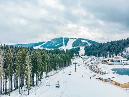 BUKOVEL, UKRAINE - December 9, 2018 - people skiing and snowboarding down by hill. winter activity. travel concept Editorial