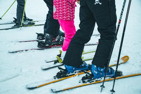 BUKOVEL, UKRAINE - December 9, 2018: legs of skiing people close up. winter vacation