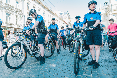 LVIV, UKRAINE – MAY 20, 2018: lviv bicycle day in center of the city. policemen on bicycles