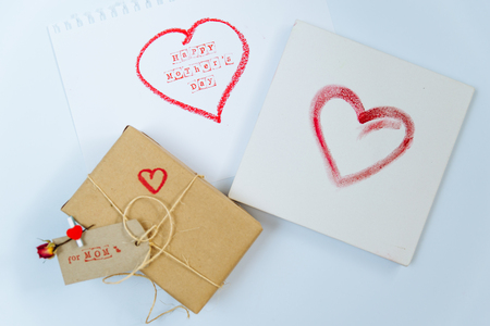 happy mother day gift in craft box with card on white paper sheet 写真素材
