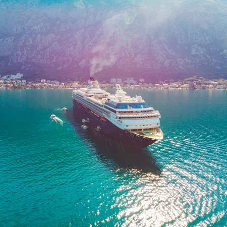 big cruise liner in sea bay. summer vacation. aerial view