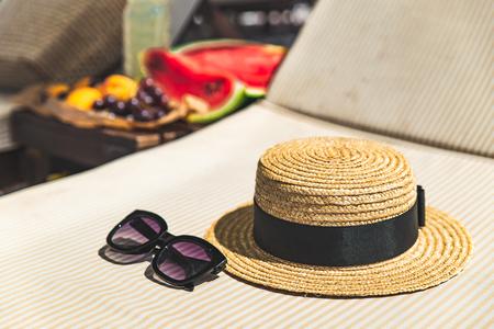 beach stuff bag towel blanket on sun longer. fruits on the table. summer vacation. sea beach