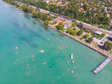 aerial view of lake with swimming people. summer time. travel concept