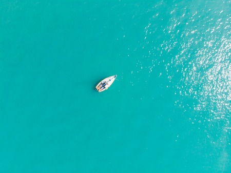 aerial view of boat in blue water. summer time