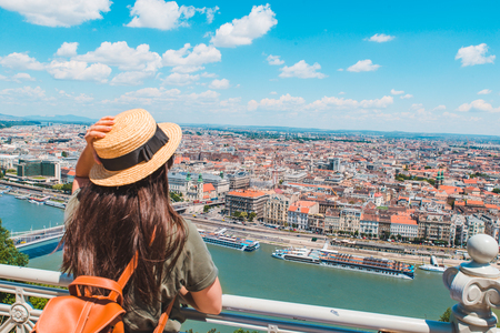 young stylish woman looking at panoramic view of budapest city. summer travel concept Banco de Imagens