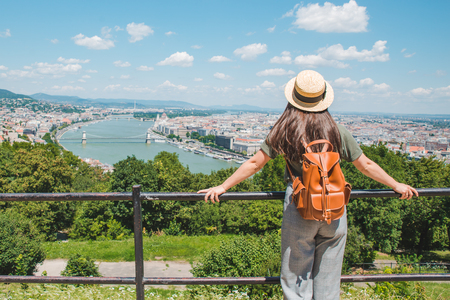 young stylish woman looking at panoramic view of budapest city. summer travel concept Imagens
